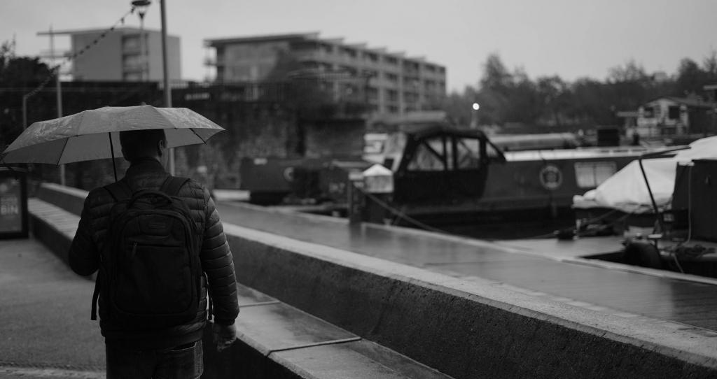 Man holding an umbrella.