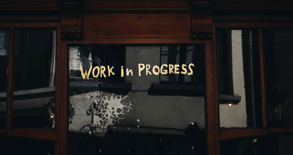 Work in progress written on a window.